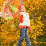 Beautiful little girl with umbrella outdoors — Stock Photo #4783798