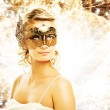 Beautiful woman in carnival mask over abstract background — Stock Photo #4783823