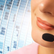 Beautiful hotline operator with headset - Stock Photo