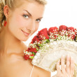 Stock Photo: Beautiful young bride with luxury bouquet of red roses. Isolated