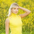 Beautiful young woman in a flower field — Stock Photo #4783930