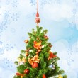Stock Photo: Christmas-tree over abstract background