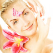 Beautiful young woman with pink lily close-up portrait. Isolated — Stock Photo
