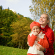 Mother and daughter outdoors — Stock Photo #4783984