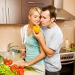 Young couple making vegetable salad in the kitchen — Stock Photo #4783985
