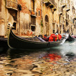 Traditional Venice gandola ride - Stock Photo