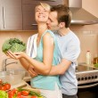 Young couple making vegetable salad in the kitchen — Stock Photo #4783988