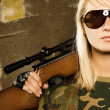 Beautiful woman soldier with a sniper rifle — Foto Stock
