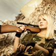 Beautiful womsoldier with sniper rifle — Stock Photo #4784071