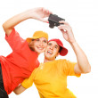 Young couple photographing themselves — Stock Photo