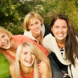 Group of happy friends having fun outdoors - Stock Photo