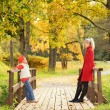 Mother and daughter relaxing outdoors — Stock Photo #4784154