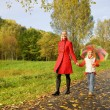 Mother and daughter walking outdoors — Stock Photo