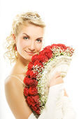 Beautiful young bride with luxury bouquet of red roses. Isolated — Stock Photo