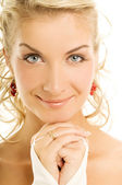 Close-up portrait of a beautiful blond girl — Stock Photo