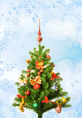 Christmas-tree over abstract background — Stock Photo