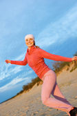 Beautiful young woman running on a beach — Stock Photo