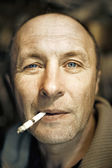 Man with a cigarette close-up portrait — Stock Photo