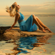 Sexy young woman flapping her blond hair near the ocean — Stock Photo #4790778