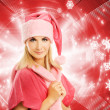 Beautiful mrs. Santa over abstract background - Zdjcie stockowe