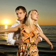 Young couple dancing near the ocean at sunset — Stock Photo #4790832