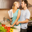 Young couple making vegetable salad in the kitchen — Stock Photo #4790844