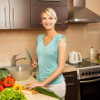 Stock Photo: Beautiful young woman making vegetarian vegetable salad