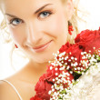 Beautiful bride hiding behind luxury bouquet of roses — Stock Photo #4790872