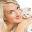 Happy young woman and sad british kitten — Stock Photo #4790910