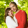 Young couple in love outdoors. Close-up portrait - Stockfoto