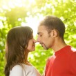 Royalty-Free Stock Photo: Young couple in love outdoors. Close-up portrait
