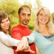 Group of young put hands on top of each other — Stock Photo