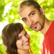 Young couple in love outdoors. Close-up portrait — Stok fotoğraf