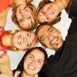 Group of happy friends standing in circle — Stock Photo