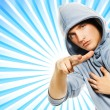 Handsome young man in a hood over abstract blue background — Stock Photo #4791175
