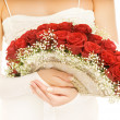 Beautiful bride with a luxury boquet of red roses. Isolated on w — Stock Photo