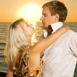 Young couple in love near the ocean at sunset — Stock Photo #4791227
