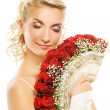 Beautiful young bride with luxury bouquet of red roses. Isolated — Stock Photo #4791248