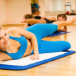 Beautiful women exercising in fitness club - Stockfoto