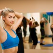 Beautiful young woman doing fitness exercise in a sport club — Stock Photo