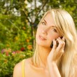 Beautiful young woman talking on the phone outdoors — Stock Photo #4791300
