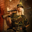 Beautiful woman soldier with a sniper rifle - Stock Photo