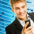 Happy young handsome man talking on the phone — Stock Photo