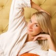 Beautiful young woman relaxing in the morning - Stock Photo