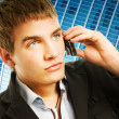Foto Stock: Young handsome man talking on the phone