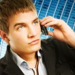 图库照片: Young handsome man talking on the phone