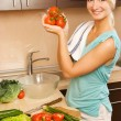 Beautiful young woman making vegetarian vegetable salad — Stock Photo #4791447