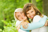 Two beautiful young women outdoors — Stock Photo