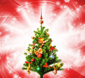 Christmas-tree over abstract red background — Stock Photo