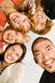 Group of happy friends making funny faces — Stock Photo